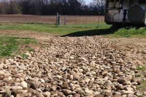 Using rock in a washout for fill and to eliminate mud. Photo credit: Tom Guthrie, MSU Extension