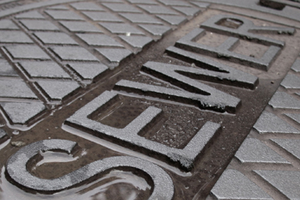 Sewer covers provide a quick point of access to underground infrastructure in legacy cities.