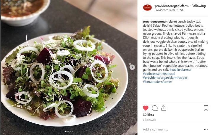 Post featuring a salad with locally produced ingredients on Providence Farm's Instagram page.