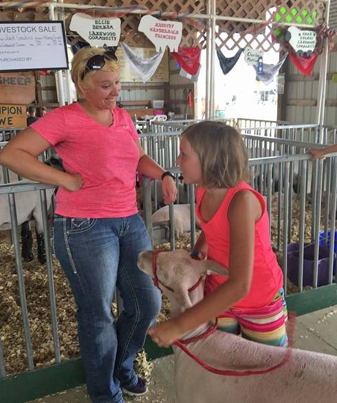 MSU Extension educator Katie Ockert and youth exhibitor Kassidy at the Berrien County Fair. Photo by Sheila Smith, MSU Extension.