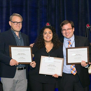 AFRE students Ryan Vroegindewey, Samantha Padilla, and Stephen Morgan after winning the AAEA student case competition