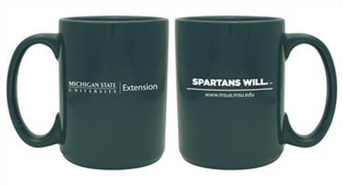 Photo of dark green extension mug with MSUE logo and Spartans Will printed on it.