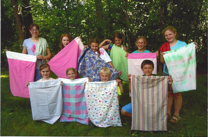 Members of the Midland County Happy Hands 4-H Club show off their stitched pillowcases.