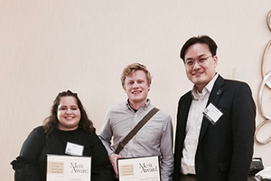 Image of MiASLA award winners standing with professor Jun-Hyun Kim holding award certificates.