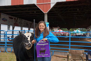Rebecca Herzog with her Grand Champion Steer at the 2015 Mecosta County Fair