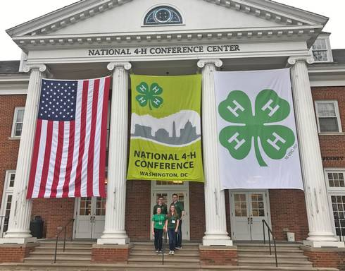 Michigan 4-H members pose for a photo at the 2017 National 4-H Conference. L-R (back row): Nathan Thorn, Tom Purves. L-R (front row): Piper Pantalone, Anne Thompson.