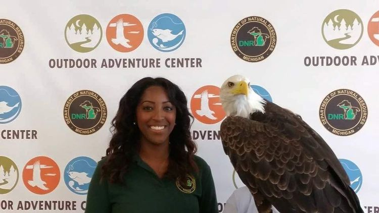 Alexis Hermiz poses with an eagle.