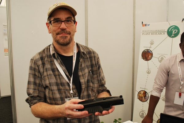 David Kramer holding the MultispeQ device used in PhotosynQ
