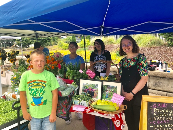 Students from the Food Systems Project at Northwest Initiative sell their produce at the Lansing Grown Pop-up market in July of 2018.