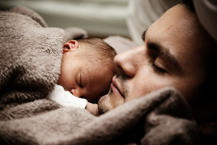 Father and baby snuggling