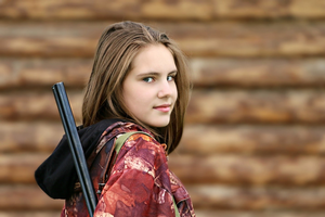 Girl with a hunting rifle
