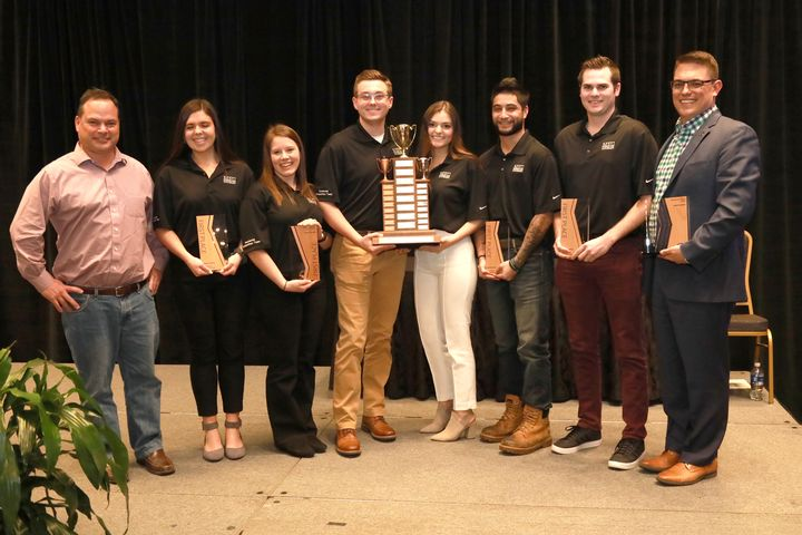 CM residential construction team holding the 1st place trophy.