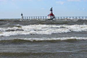 South Haven pier is shown surrounded by waves and high waters in April 2020. Photo: Courtesy of J. Sandberg
