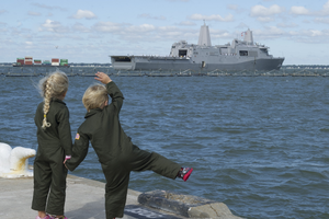 Children waving to Navy ship