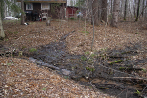 Sewage discharging directly to creek. Photo credit: Marquette County Health Department