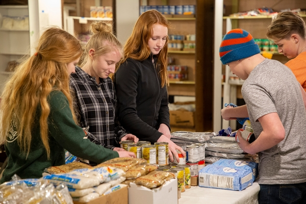 Youth collecting food items
