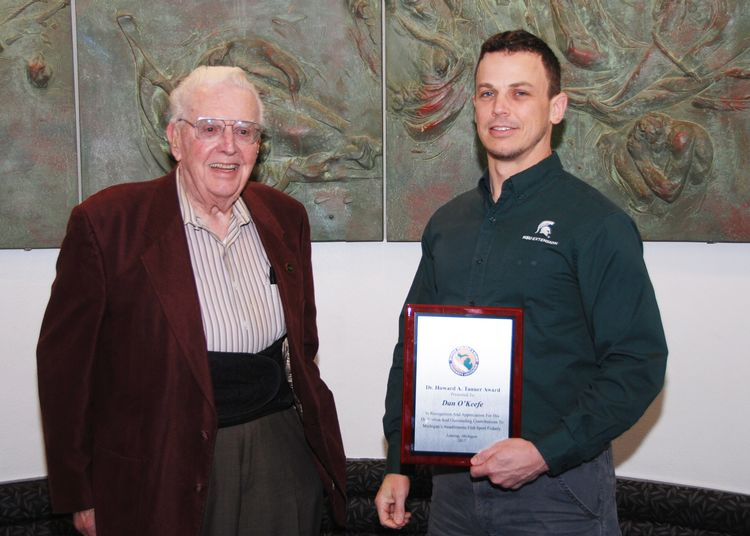 Michigan Sea Grant Extension educator Dr. Dan O'Keefe (right) recently received the Dr. Howard Tanner Award from the Michigan Steelheaders and Salmon Fishermen's Association. Dr. Tanner is shown at left. Courtesy photo