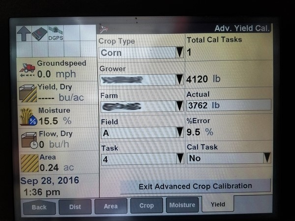 yield monitor screen showing the calibration functions on a combine.