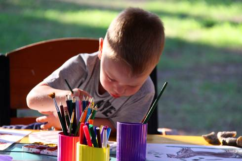 Ask open-ended questions about artwork to encourage children to talk about what they are doing.