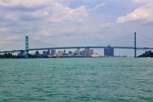 Looking upstream on the Detroit River toward the Ambassador Bridge and Downtown Detroit.  Picture by I Will Shoot You Photography.