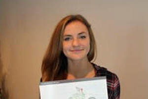 Malley M., an eighth-grade student at All Saints Catholic School in Alpena, Mich., displays her winning artwork. Malley's illustration is the November calendar page in the NOAA Marine Debris Calendar. Courtesy photo