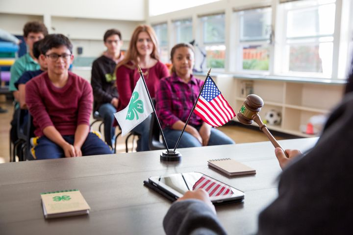 Youth in a 4-H club meeting