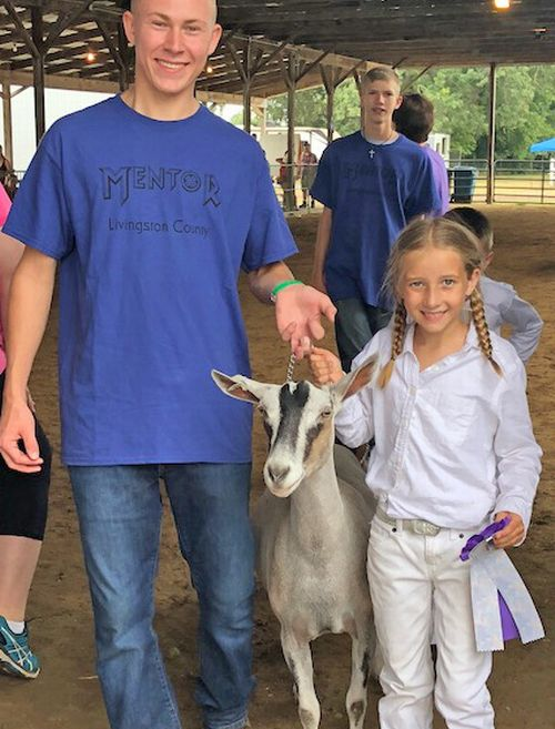Girl and goat at fair