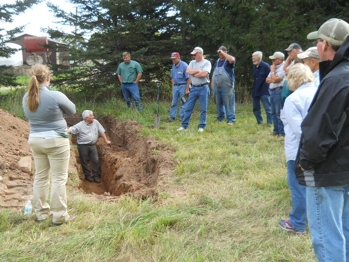 Paul Gross discusses soil health issues from a soil trench in Rumely, Michigan, at field day on Sept. 13, 2016.