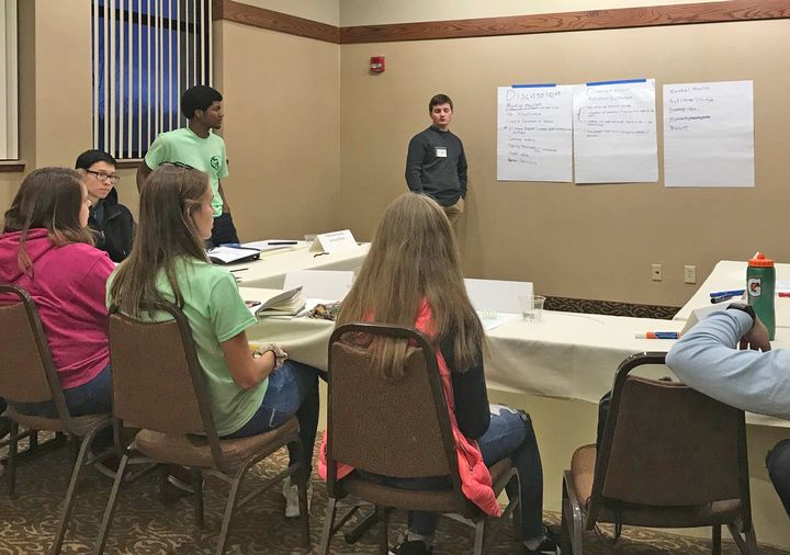 4-H Capitol Experience participants working in issue groups