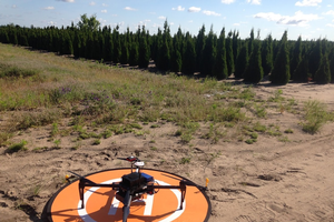 Drone preparing for flight to inventory field of arborvitae.