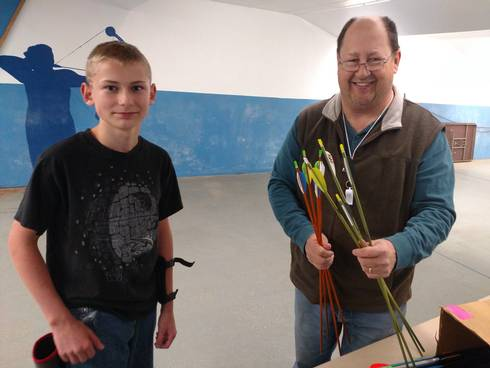 Erick Kestila, right, with a participant in the 4-H After School Archery Program in Delta County.