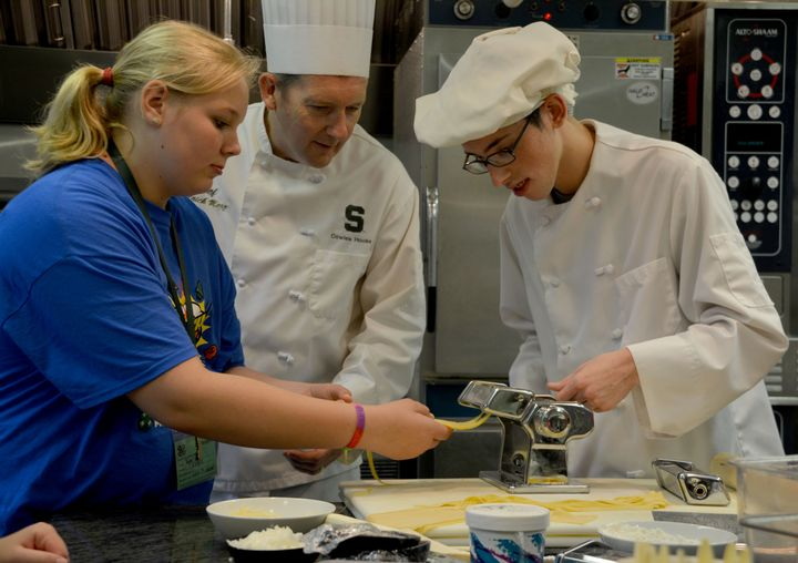 Youth engage with culinary staff and experts at the 2015 4-H Exploration Days.