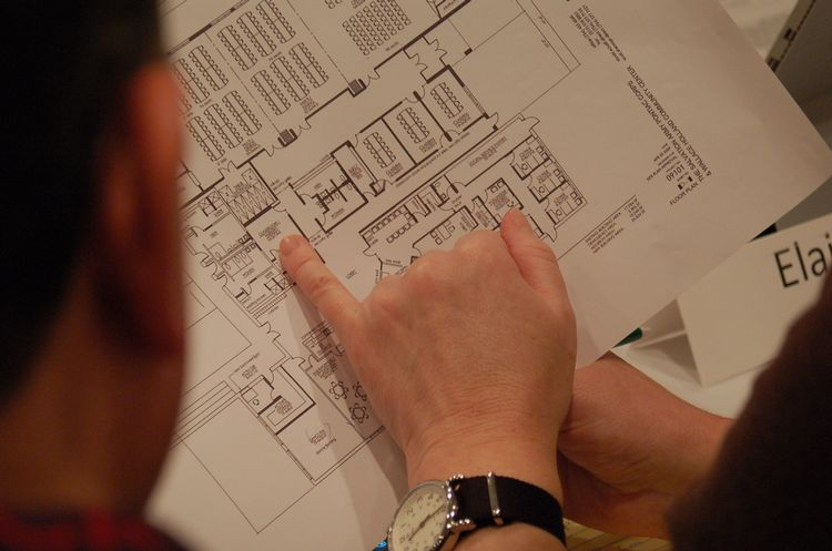 Reviewing a zoning permit application site plan. MSU Extension Kurt H. Schindler.