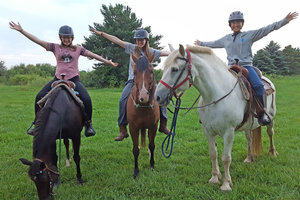Chiori enjoying horseback riding with her host sisters.