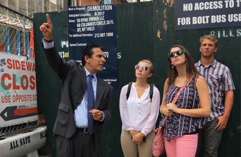 Peter Riguardi points out details to three SPDC students during a tour of Hudson Yards in New York City.