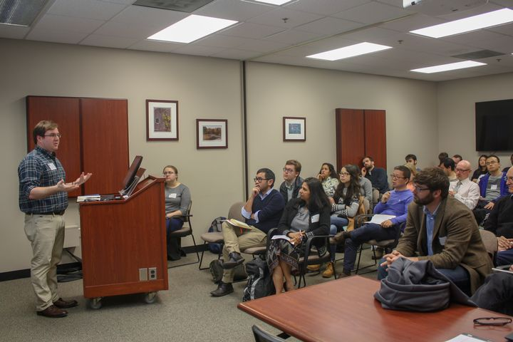 AFRE PhD student Stephen Morgan presents to a full room at the AFRE Graduate Research Symposium.