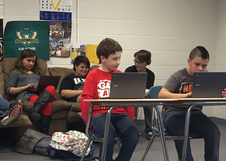 Alcona County youth engaged in computer coding.
