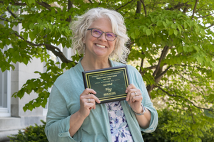Dale Elshoff with her Advisor of the Year Award outside Agriculture Hall, MSU