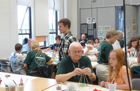 Photo of grandparents working with students on a landscape architecture project during MSU Grandparents University.