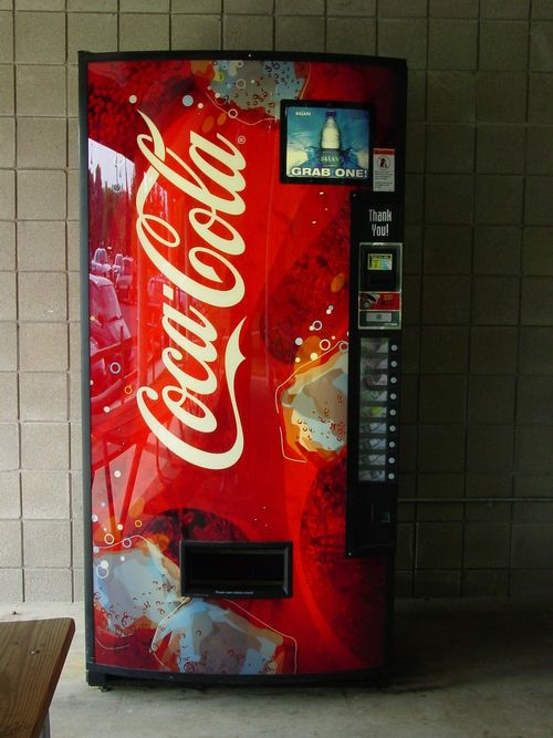 Coca-Cola vending machine in a hallway.