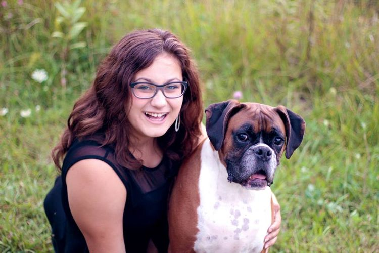 Lansing youth Kendra Rocha and her dog Nova