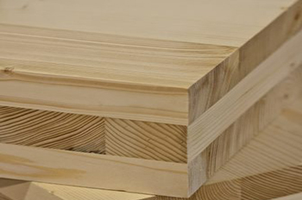 Cross-laminated timber products show the alternating directions in the layers of wood. Photo by Structurlam.