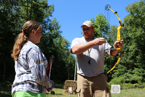 4-Hers practicing safety while using bows