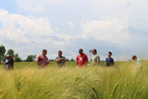 Visitors to last year's UPREC Field Day learn about the latest crop variety trials conducted at the center.