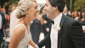 Newlywed couple smiling.