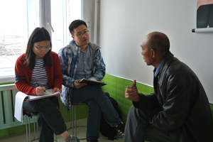MSU scientists interview a farmer in Heilongjiang China
