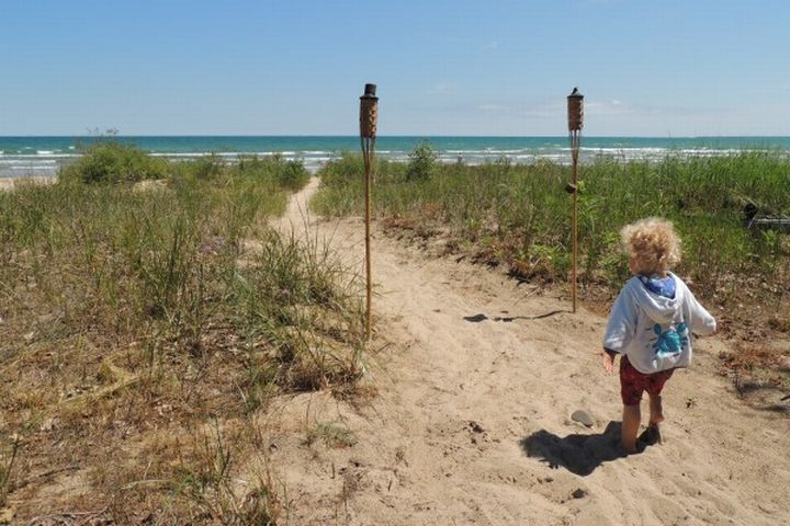 Narrow pathways to the beach allow for scenic access to waterfront while protecting critical coastal habitats. Brandon Schroeder | Michigan Sea Grant