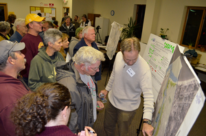 Community members review the design alternatives during the charrette open house; Photo credit: Todd Marsee