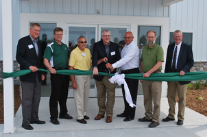 Representatives from MSU and the agriculture industry cut the ribbon at the new SVREC Agricultural Education Center.