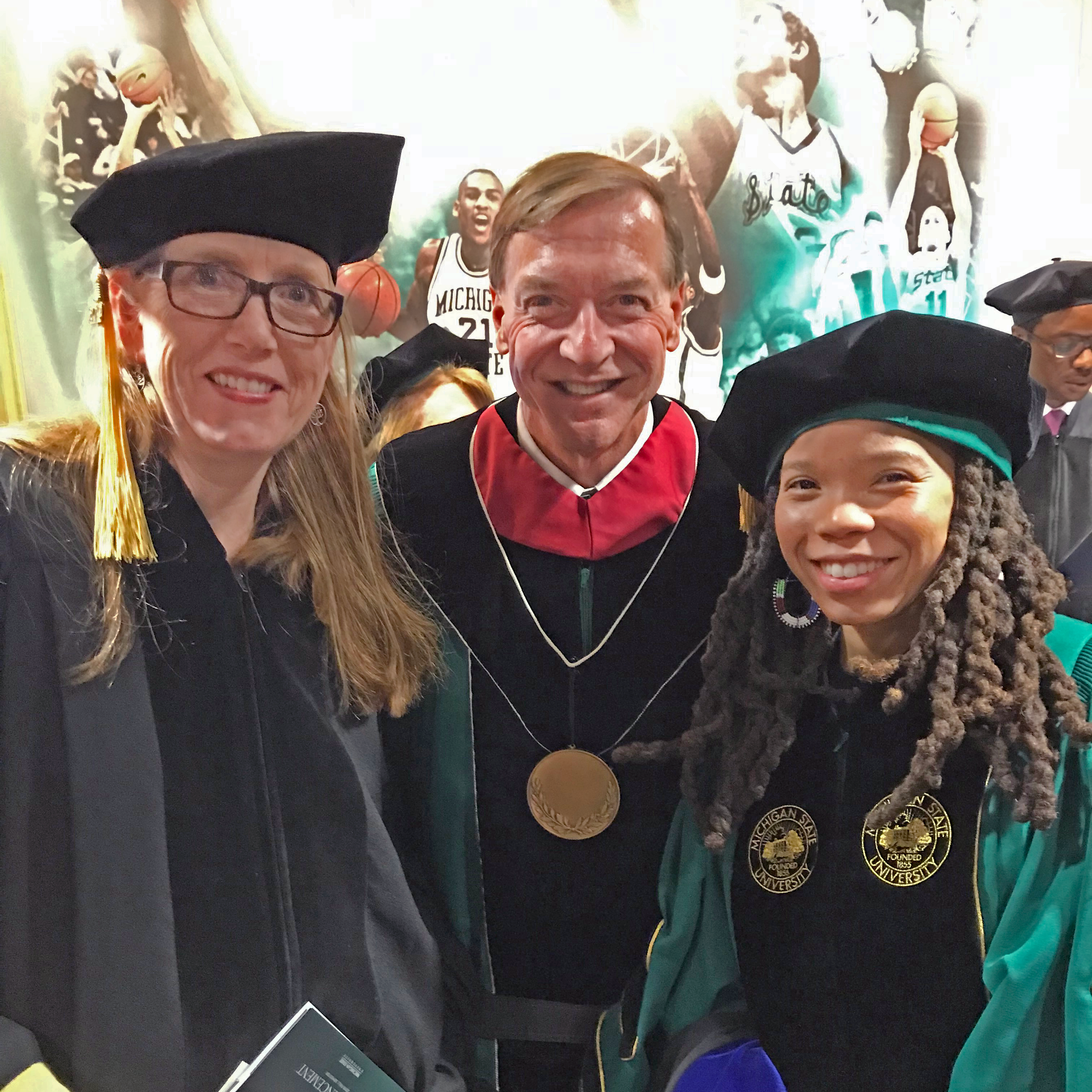 Two CSUS graduate students at the MSU Advanced Degree Commencement with President Stanley